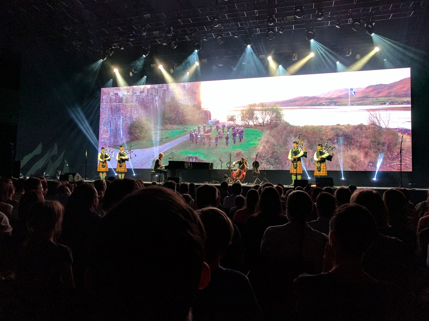 Four bagpipers accompanying the Piano Guys