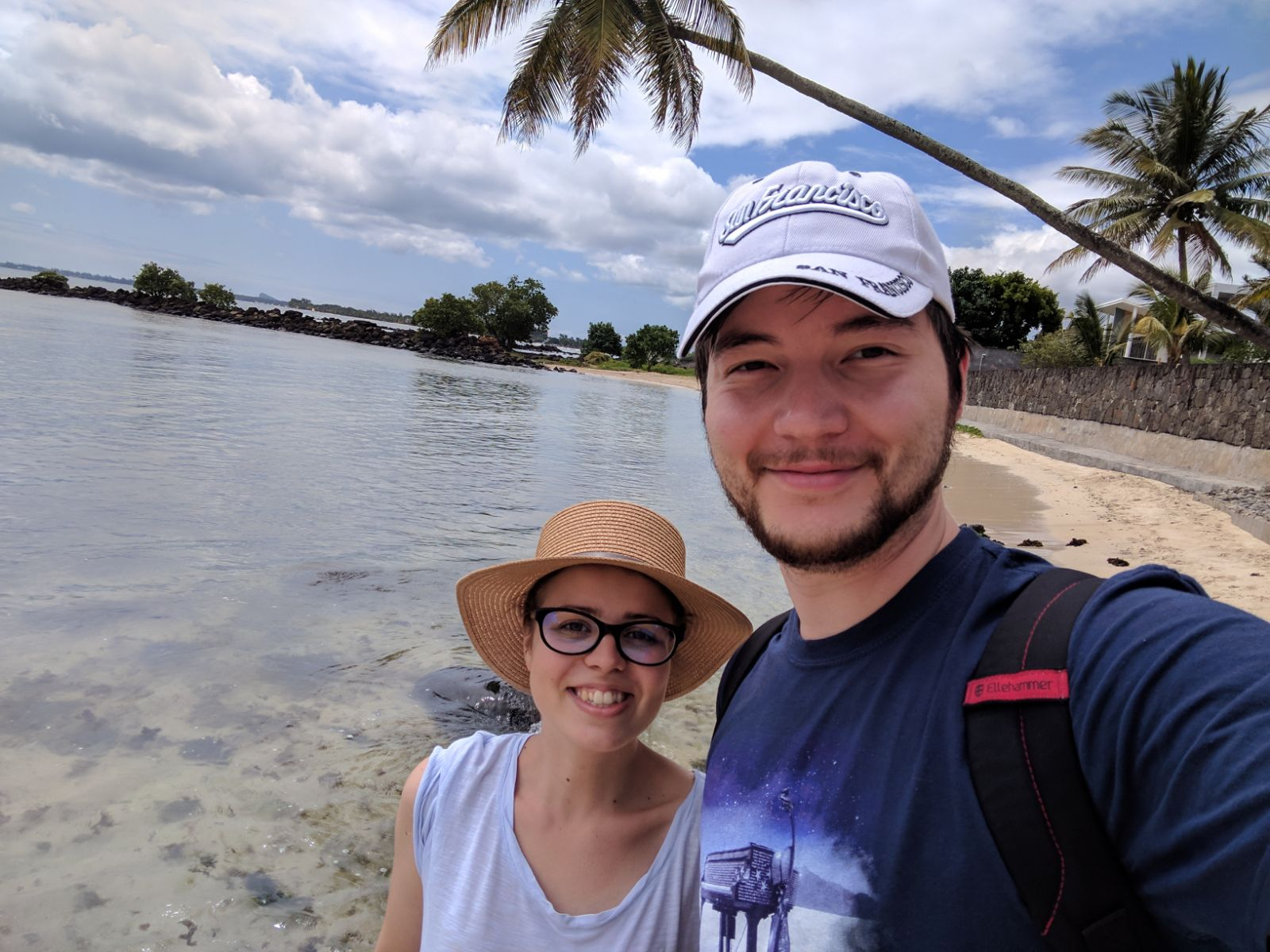 Us smiling on a beach